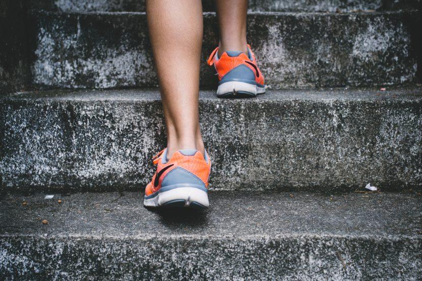 foot shot of woman climbing stairs
