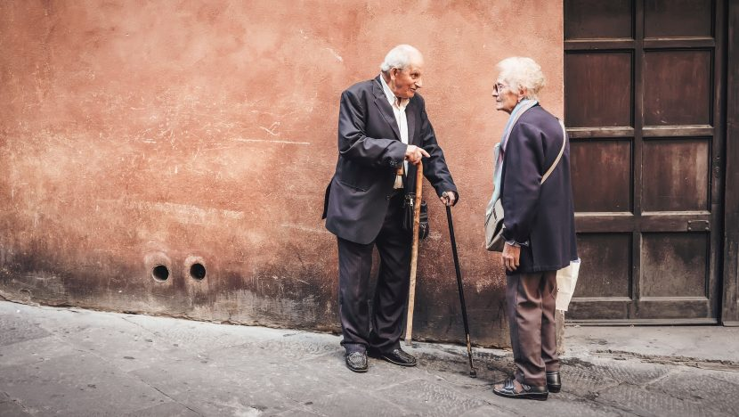 old couple talking in the street
