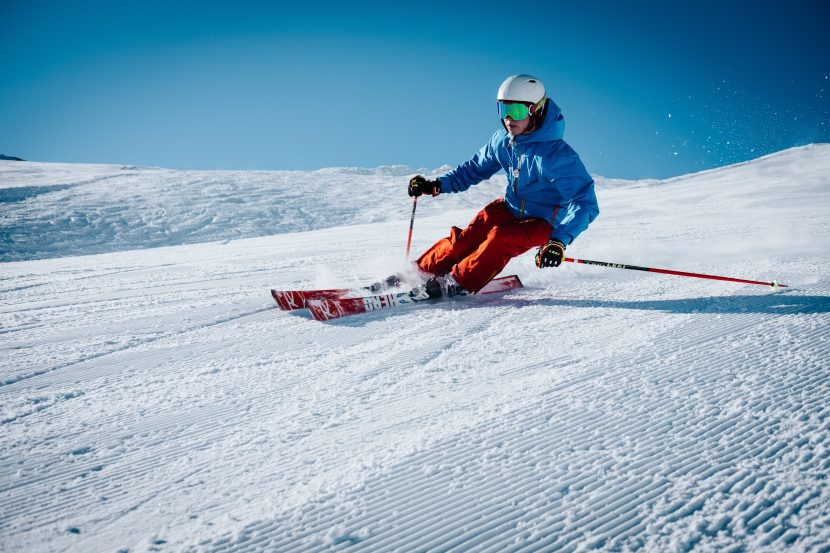 man skiing down slope